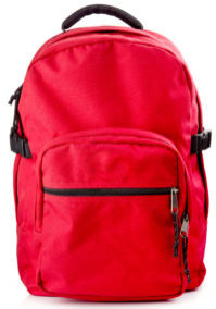 Red backpack standing on white background
